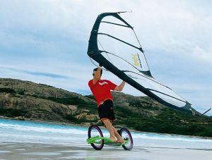 Kitewing on the beach with a Dirtsurfer